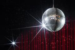 Nightclub disco ball. Party disco ball with stars in nightclub with striped red and black walls lit by spotlight, nightlife entertainment industry Stock Images
