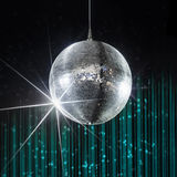 Nightclub disco ball. Party disco ball with stars in nightclub with striped turquoise and black walls lit by spotlight, nightlife entertainment industry Royalty Free Stock Images