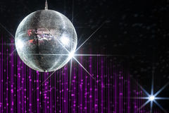 Nightclub disco ball. Party disco ball with stars in nightclub with striped violet and black walls lit by spotlight, nightlife entertainment industry Stock Photos