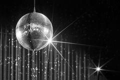 Nightclub disco ball. Party disco ball with stars in nightclub with striped white and black walls lit by spotlight, nightlife entertainment industry Stock Photo