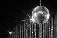 Nightclub disco ball. Disco ball with stars in nightclub with striped white and black walls lit by spotlight, party and nightlife entertainment industry Royalty Free Stock Photography