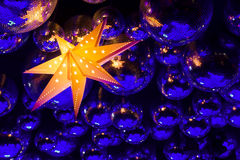 Nightclub disco balls. Nightclub blue disco balls and gold glowing star in colorful festive lights in dance club Royalty Free Stock Photos