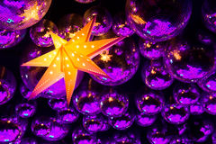 Nightclub disco balls. And glowing star in colorful festive lights in dance club Royalty Free Stock Images