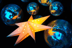 Nightclub disco balls. And glowing star in colorful festive lights in dance club Royalty Free Stock Photo