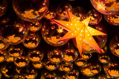 Nightclub disco balls. Nightclub gold disco balls and glowing star in colorful festive lights in dance club Stock Photo