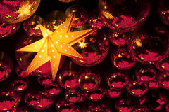 Nightclub disco balls. Nightclub red disco balls and gold glowing star in colorful festive lights in dance club Stock Image