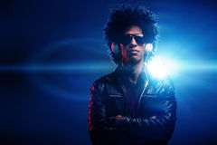 Nightclub dj. Cool nightclub party dj portrait with headphones lighting flare and sunglasses Stock Image