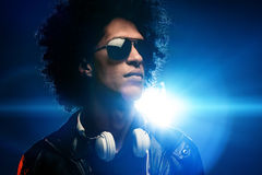 Nightclub dj. Cool nightclub party dj portrait with headphones lighting flare and sunglasses Stock Images