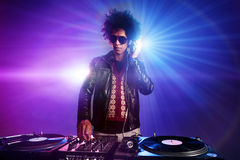 Nightclub dj party. Nightclub dj playing music on deck with vinyl record headphones light flare clubbing party scene Stock Photos