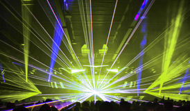 Nightclub Lasers and Crowd. Huge Laser engulfing the Dancefloor at a nightclub party Stock Photo