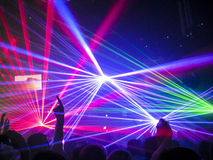 Nightclub / Rave Lasers, People Having Fun. Colourful Nightclub lasers shining down on a crowd, with people having a good time Royalty Free Stock Images