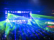 Nightclub Lasers, Crowd Having Fun. Lasers shining down on a large crowd at a music concert Stock Photography