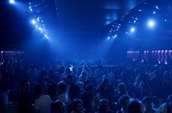 Nightclub party with lightshow. Young girls and boys are having fun in a nightclub Stock Photo