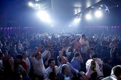 Nightclub party people. Young girls and boys are having fun at a concert in a nightclub Stock Photo
