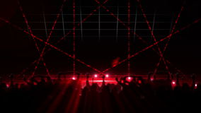Nightclub with red laser show and dancing crowd stock video