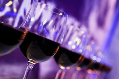 Nightclub red wine glasses Stock Photo