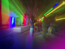 Nightclub or rock concert dancing. Picture of rock concert, music festival, New Year eve celebration, party in nightclub, dance floor, disco club, many people Stock Photos
