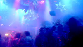 Nightclub Scene. With christmas decor and dance floor crowd in motion Stock Photo
