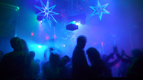 Nightclub Scene. With christmas decor and dance floor crowd in motion Royalty Free Stock Image