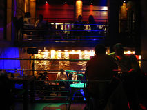 Nightclub in Toledo,Spain. Interior view of a popular nightclub in Toledo, Spain. Silhouettes of people sitting down at tables and having fun Stock Image
