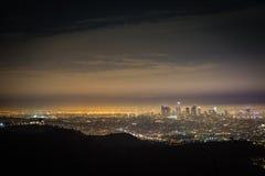 Nightfall Across The Los Angeles Basin. A glowing view of the Los Angeles Basin at night from the surrounding hills Stock Image