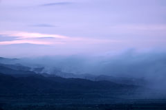 Nightfall mountain scenery. The nightfall landscape of mountains in clouds Royalty Free Stock Image