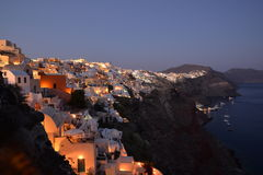 Nightfall at Oia, Santorini. Nightfall at the village of Oia in the northern end of the Greek island of Santorini with whitewashed houses built into the cliffs royalty free stock photography
