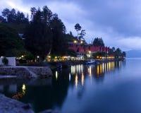 Nightfall over Lake Toba resort. A resort in the village of Tuktuk on Samosir Island in Sumatra`s Lake Toba at nightfall. Most of Samosir`s tourist royalty free stock image