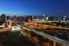 At nightfall, Shanghai. Roads getting busy in Xujiahui area of Shanghai during the dusk period Stock Images