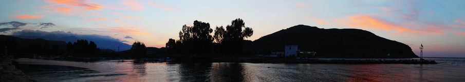 Nightfall on Turtle River. Georgioupolis, Crete, at sunset, with the pink clouds reflecting on the mouth of Turtle River, as the Almiros River is marketed to royalty free stock photo