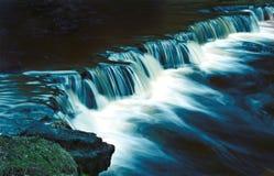 Nightfalls. Waterfall at night light by the Moon Royalty Free Stock Photography