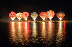 Nightglow with hot air balloons Stock Photo