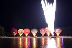 Nightglow met hete luchtballons Stock Foto