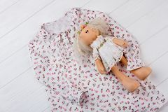 Nightgown and stuffed doll. Floral print and ruffles. Adorable gift set for daughter`s birthday Royalty Free Stock Images