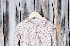 Nightgown for young girl. Floral pattern print on cotton fabric. Cozy sleepwear for sweet dreams Royalty Free Stock Photos