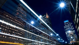 Nightime in the financial city district. With bus going past stock photography