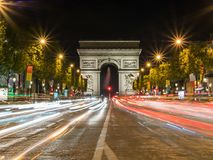 Nightime view of the Arc de Triomphe. Nightime view of the Arc de Triumph from the Champs-Élysées, Paris, France Royalty Free Stock Photos