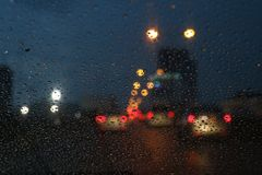 Nightlife background bokeh and raindrop on glass blurred bokeh lighting colorful condensation royalty free stock image