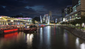 Nightlife at Clarke Quay Singapore River. SINGAPORE, SINGAPORE - MAR 13 : Nightlife at Clarke Quay Along Singapore River Panorama at Blue Hour on Mar 13, 2013. A Stock Photography