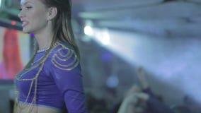 Nightlife at club, disco on dance floor, flashing lights, go-go. Stock footage stock video