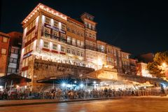 Nightlife on the crowded promenade of the Douro River with cafes and restaurants in Porto stock images
