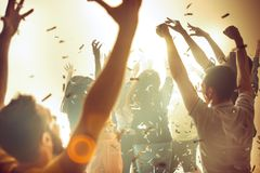 Nightlife and disco concept. Young people are dancing in club. Nightlife and disco concept. Young people are dancing in club or outdoor in sunlight. Happiness stock photography