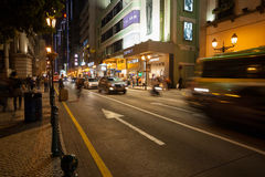 Nightlife on downtown street in Macau. MACAU, CHINA - OCTOBER 31, 2012: Nightlife on downtown street. Macau is visited by approximately 29 million tourists from Royalty Free Stock Photos