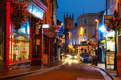 Nightlife in Ennis, Ireland. Nightlife at the medieval old part of the popular touristic city Ennis, Ireland. It hosts many restaurants and bars, blurry people Stock Photography