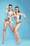 Nightlife. Glamorous Women Dancers in Fantastic Masks Royalty Free Stock Photography