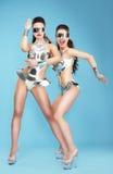 Nightlife. Glamorous Women Dancers in Fantastic Masks royalty free stock photography