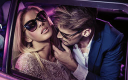Nightlife - handsome man seducing a beautiful lady Stock Images