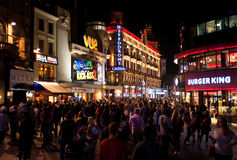 Nightlife in London. People enjoy the Friday nightlife in Leicester Square in London on August 16, 2013. Leicester Sq is a pedestrianised square in the West End Royalty Free Stock Photography