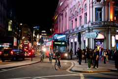 Nightlife in London. People stroll in Piccadilly on a Friday night in London on October 4, 2013. From pubs to upmarket bars, nightclubs to a vibrant gay scene Royalty Free Stock Photo