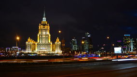 Nightlife in Moscow, Russia. MOSCOW, RUSSIA - MARCH 17, 2016: View of Hotel Ukraina with river and skyscrapers at the background. Time-lapse of the car traffic stock video
